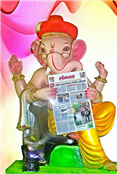 Bappa reads Lokmat... A scene set up at one of the Ganesh Mandals, Aurangabad.