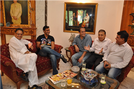 Actors Ajay Devgn and Akshaye Khanna are all smiling attention