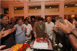 Evergreen actor Dev Anand cuts birthday cake at a programme in Mumbai. Also seen are Vijay Darda, Rajendra Darda, R R Patil and Sushilkumar Shinde.